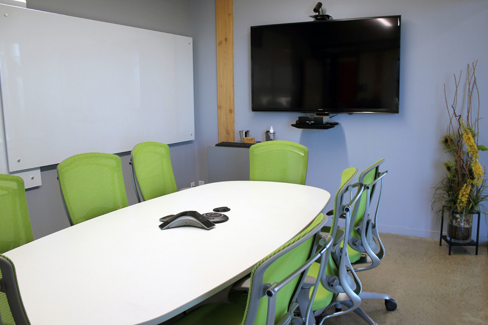 "Aurora Boardroom At The Mosaic Centre Featuring A 70"" Television, ClickShare System And Whiteboards"